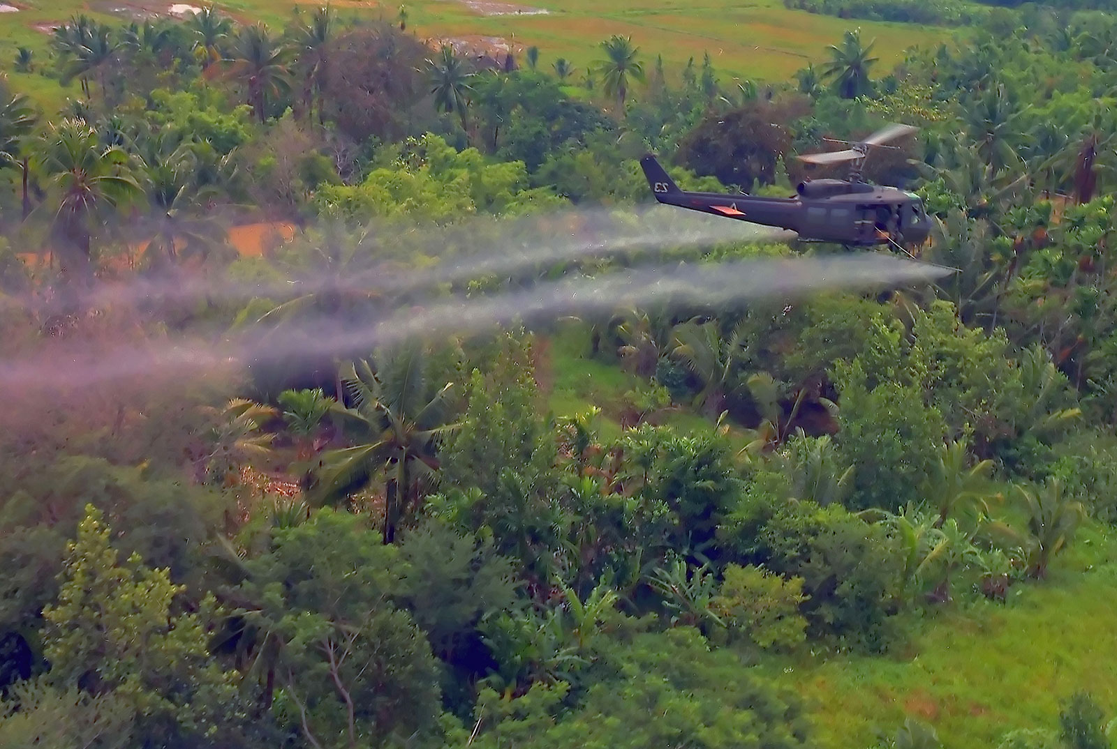 Image of an U.S. military helicopter spraying Agent Orange in Vietnam.