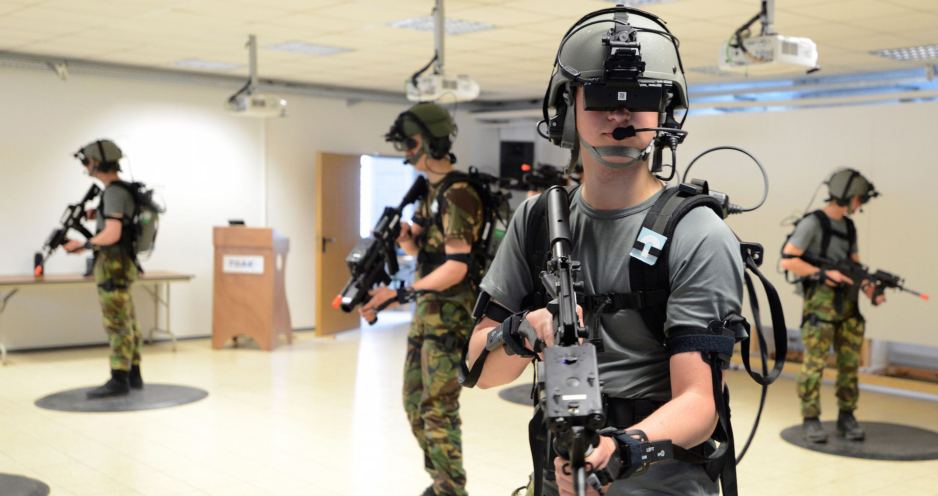 Soldiers using virtual reality training to simulate difficult combat situations.
