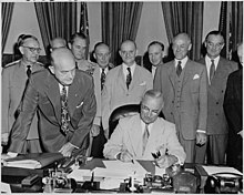 President Truman during the signing of the National Security Amendment Act of 1949.