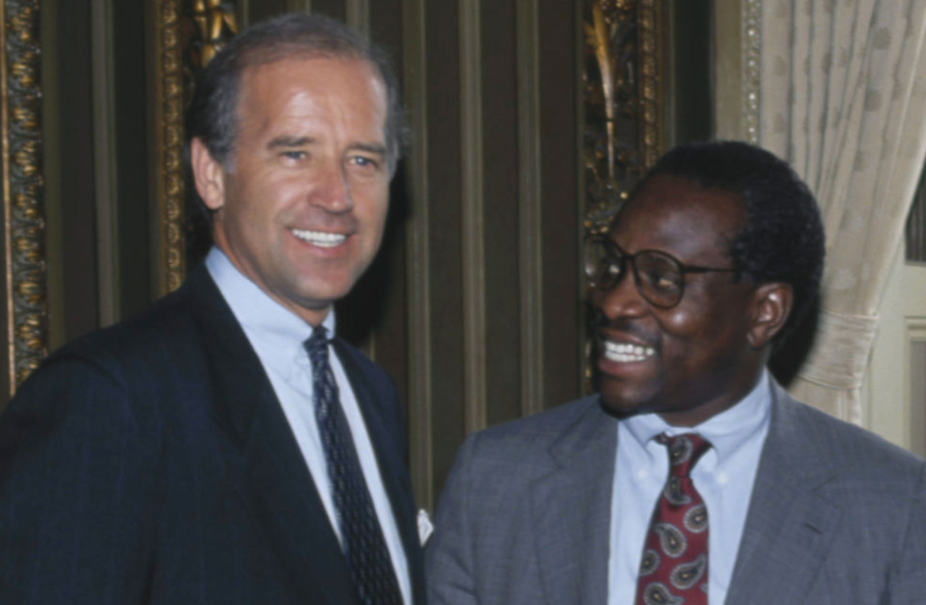 Biden poses with then-Supreme Court nominee Clarence ThomasClarence Thomas (1991)