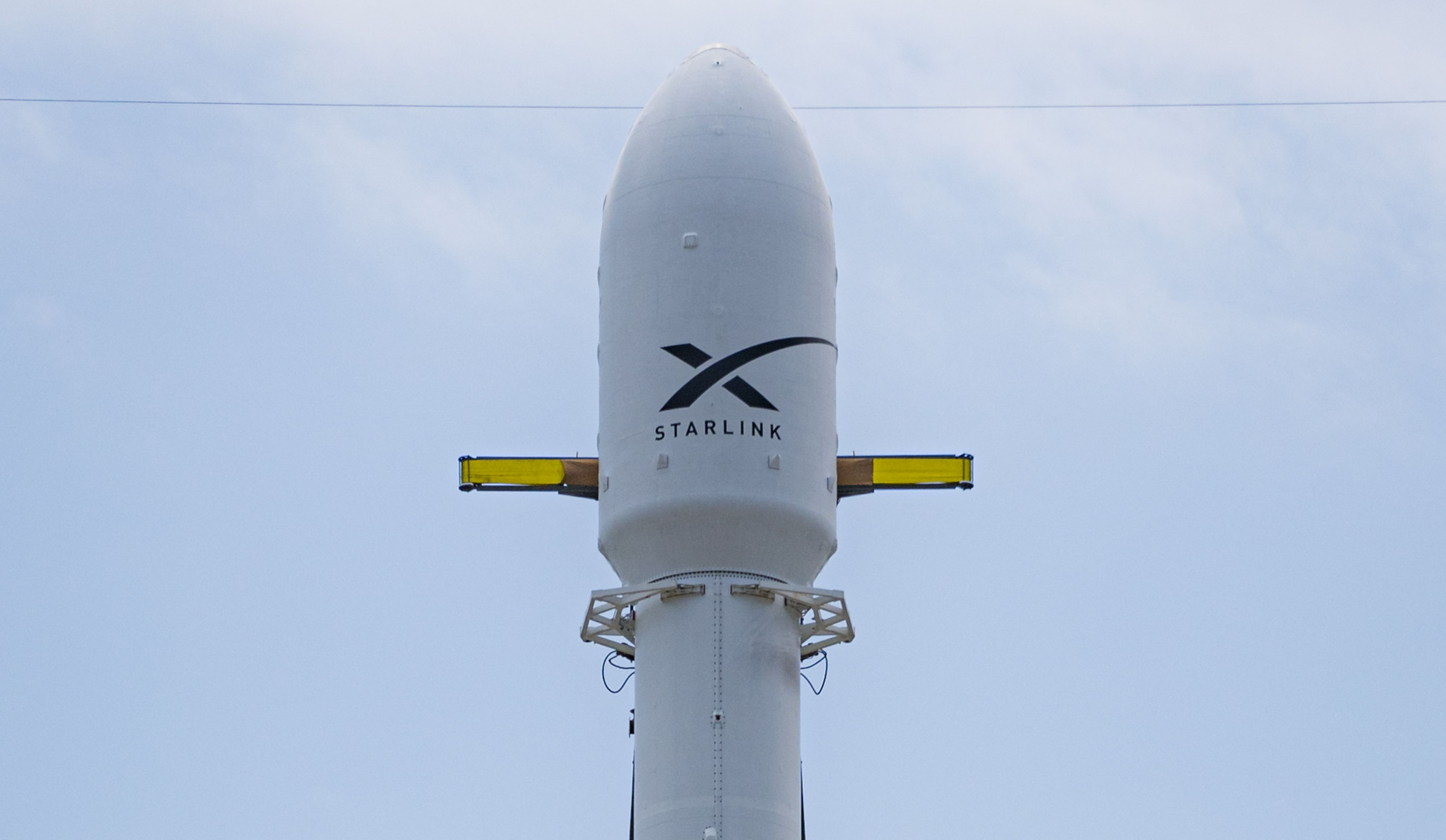 Falcon 9 rocket with a fairing payload carrying Starlink satellites.